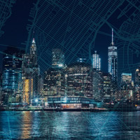 A photo of the New York City skyline with an overlay of a map of the city.