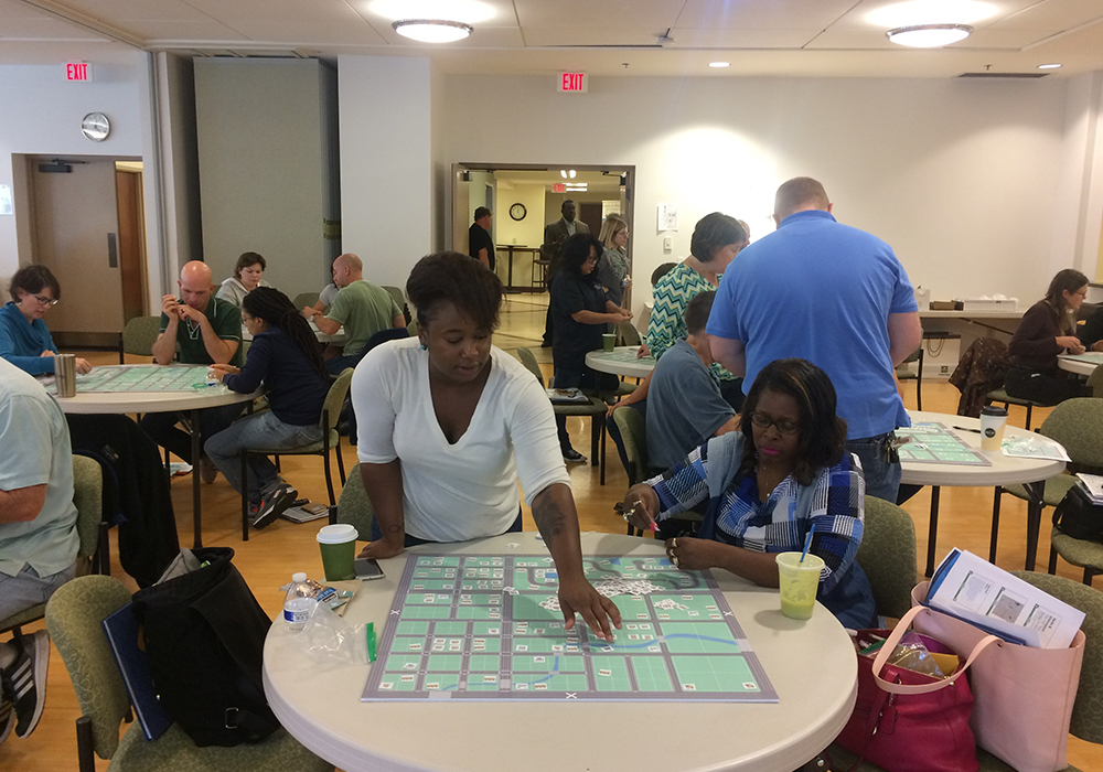 The student becomes the planner: PPA participants arrange a mix of land uses on a game board.
