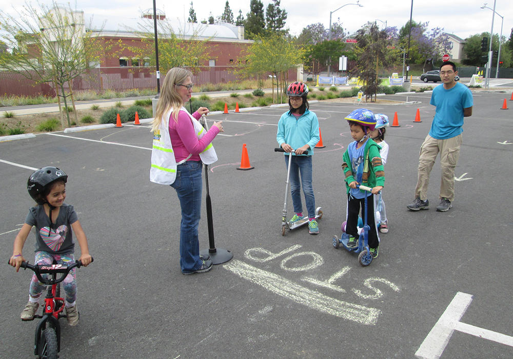 Children learn skills to stay safe while riding on streets and pathways during the Go Human event in Brea, California.