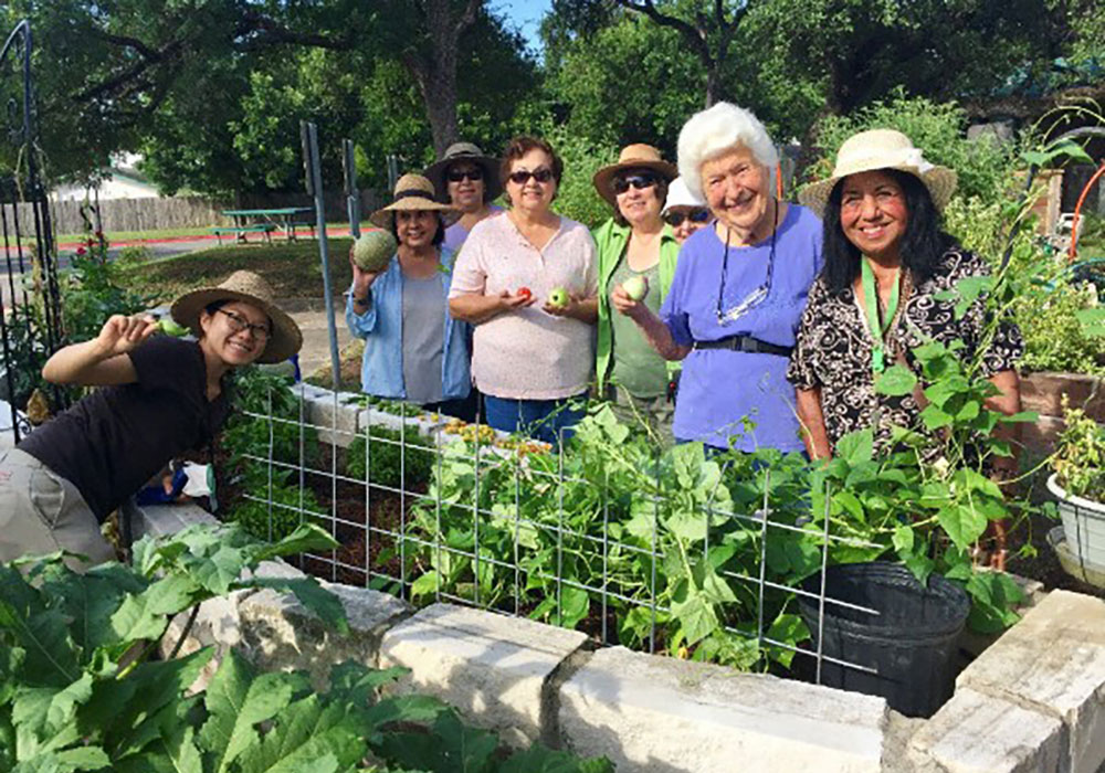 Residents work in one of Austin, Texas' community gardens.