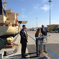 Port Chairwoman Ann Moore participates with Congressman Scott Peters and Port Vice Chairman Bob Nelson in a news conference in 2013 at one of the Port's maritime cargo terminals, illustrating Moore's collaboration with federal agencies.