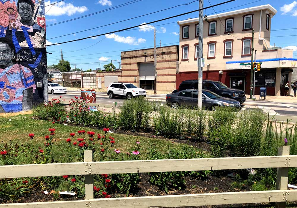 Before and after restoration photos of a vacant lot in the Mantua neighborhood of Philadelphia.