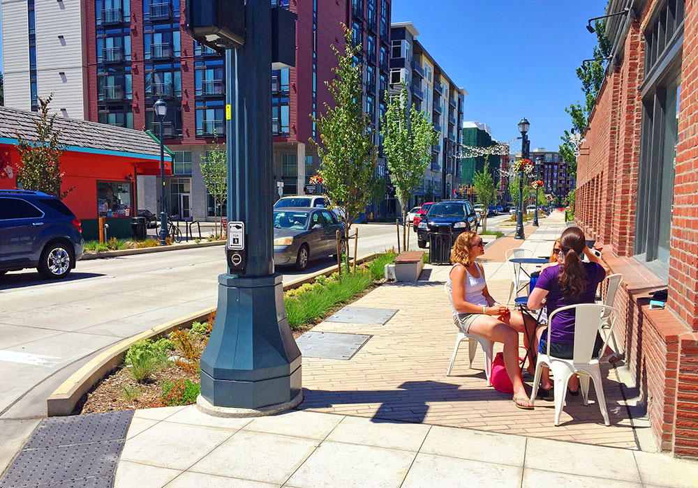 Residents enjoy a sidewalk cafe on Cleveland Street. Photo courtesy City of Redmond.