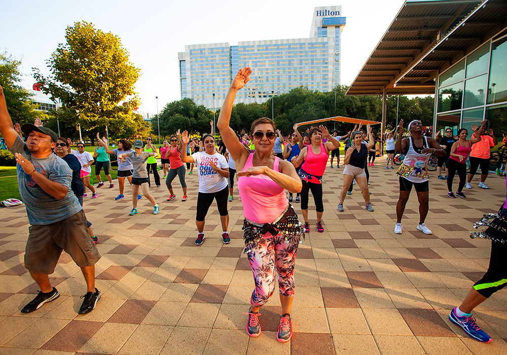 Residents enjoy an outdoor fitness class. Photo by Katya Horner.