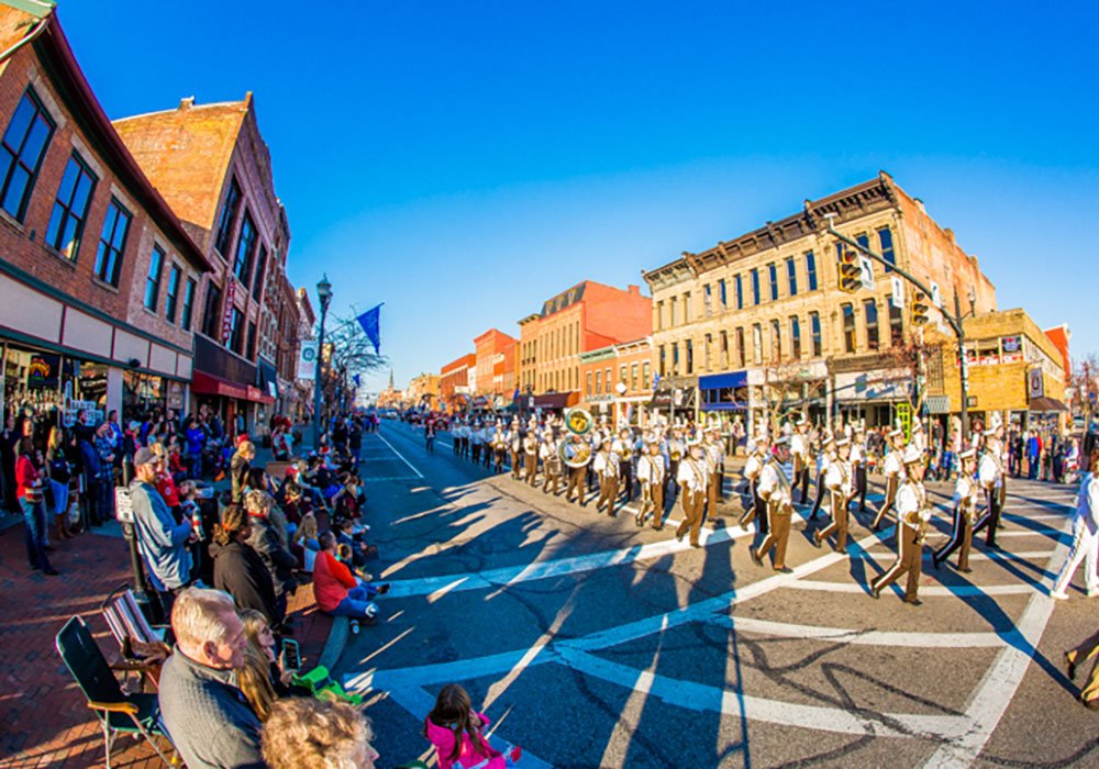 A parade marches through downtown Delaware. Photo courtesy City of Delaware.