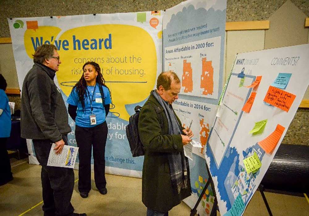 Figure 8. Community members interacting with planning staff at an open house (City of Minneapolis)