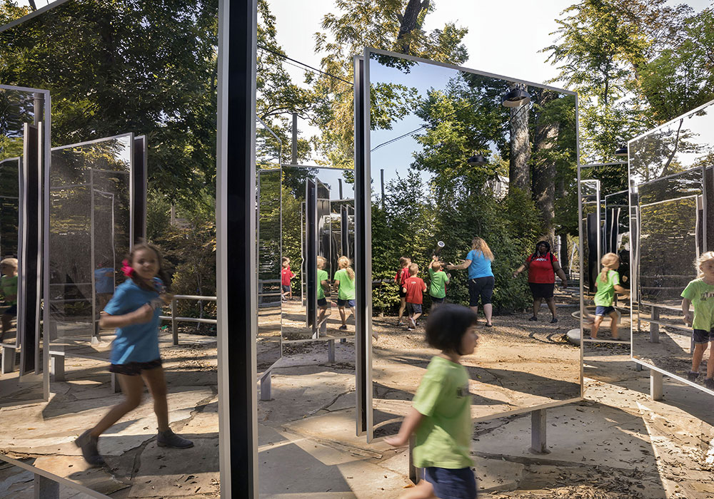 Children playing in a mirrored play area. Photo courtesy A Gathering Place for Tulsa.