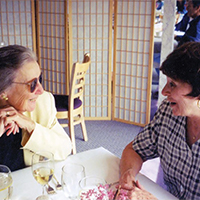 Professor McCoy enjoys lunch with a colleague. Friends recall her easy grace and interest in the careers of those she mentored.