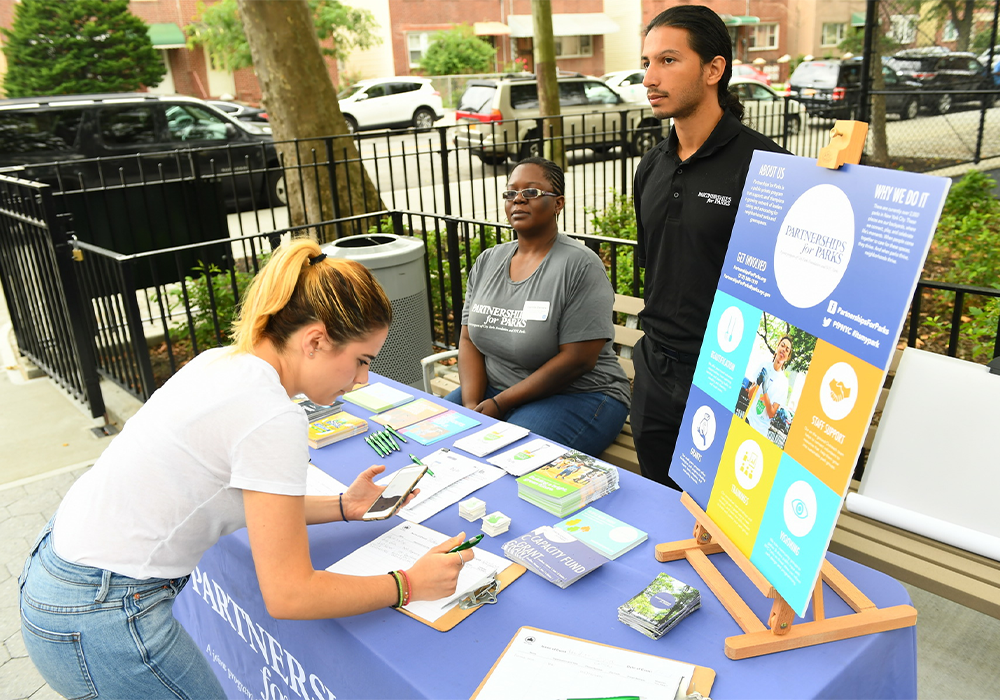 NYC Parks and Partnerships for Parks engage in community outreach for CPI. To date, the team has cultivated long-term community partners at 55 of 67 CPI sites. Photo Credit: Malcolm Pinckney/NYC Parks
