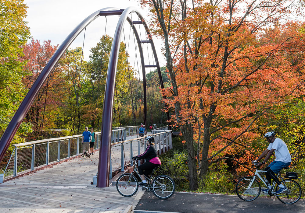 Cyclists and pedestrians use the Harvest River Bridge. Photo by Anton Grassl.