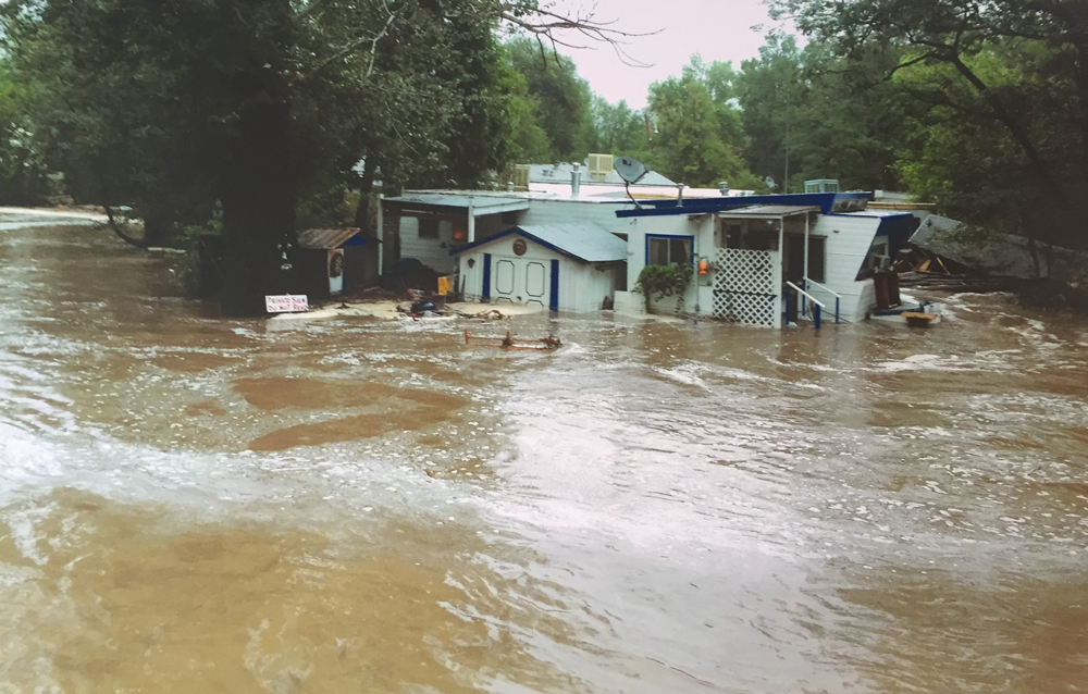Figure 5. September 2013 flooding of the St. Vrain Creek in the Confluence MHC in Lyons, Colorado. Photo courtesy C. Chrystal DeCoster.