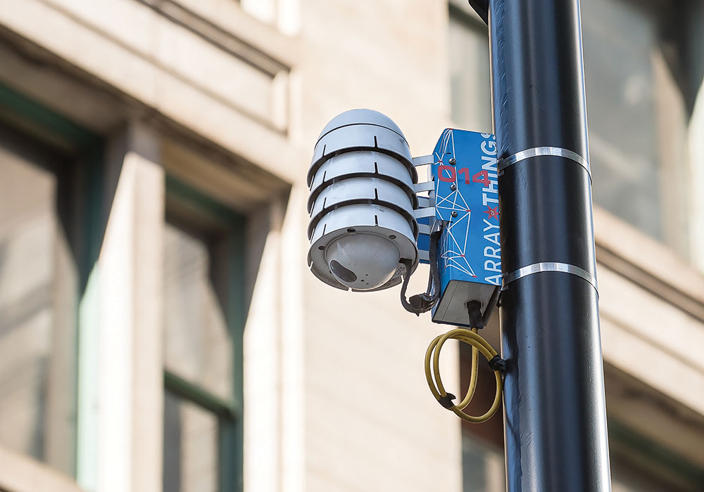In Chicago, Array of Things nodes are attached to 200 utility poles. Data from the network of sensors, including weather instruments, pollution measurement equipment, cameras, and microphones, is available to researchers and businesses. Photo courtesy Argonne National Laboratory.