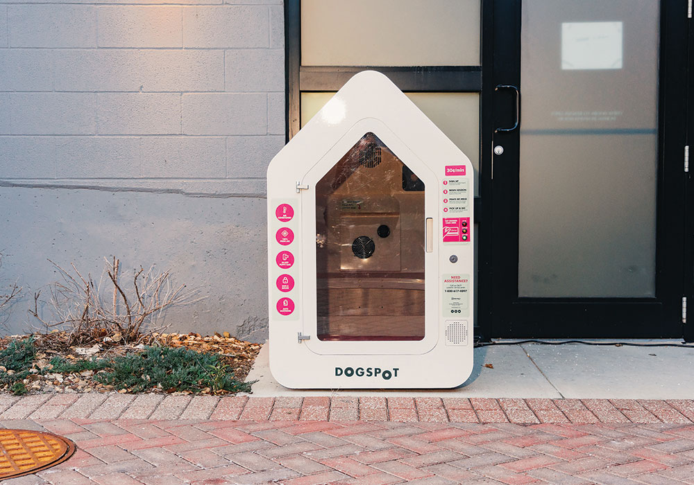 In Kansas City, dog houses designed by Dogspot, a tech startup, are outfitted with cameras and temperature controls. People can leave pets in the secure kennels while they run quick errands. Photo by Barrette Emke for The New York Times.
