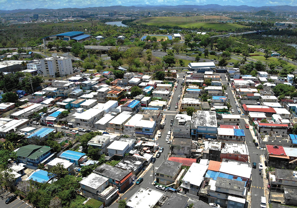 April 23, 2019:  A drone photo shows the ubiquitous blue tarps that cover roofs in Puerto Rico. In June, a Puerto Rican government official told CBS News that about 30,000 damaged houses still use the tarps. Photo by Ivis García.
