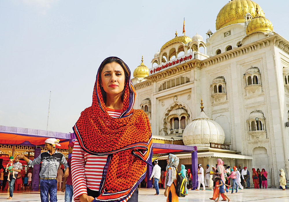 Presenter Anita Rani stands in front of the Gurudwara Bangla Sahib, a Sikh temple in Dehli, India. The temple is an example of the city's diversity. Photo courtesy BBC.