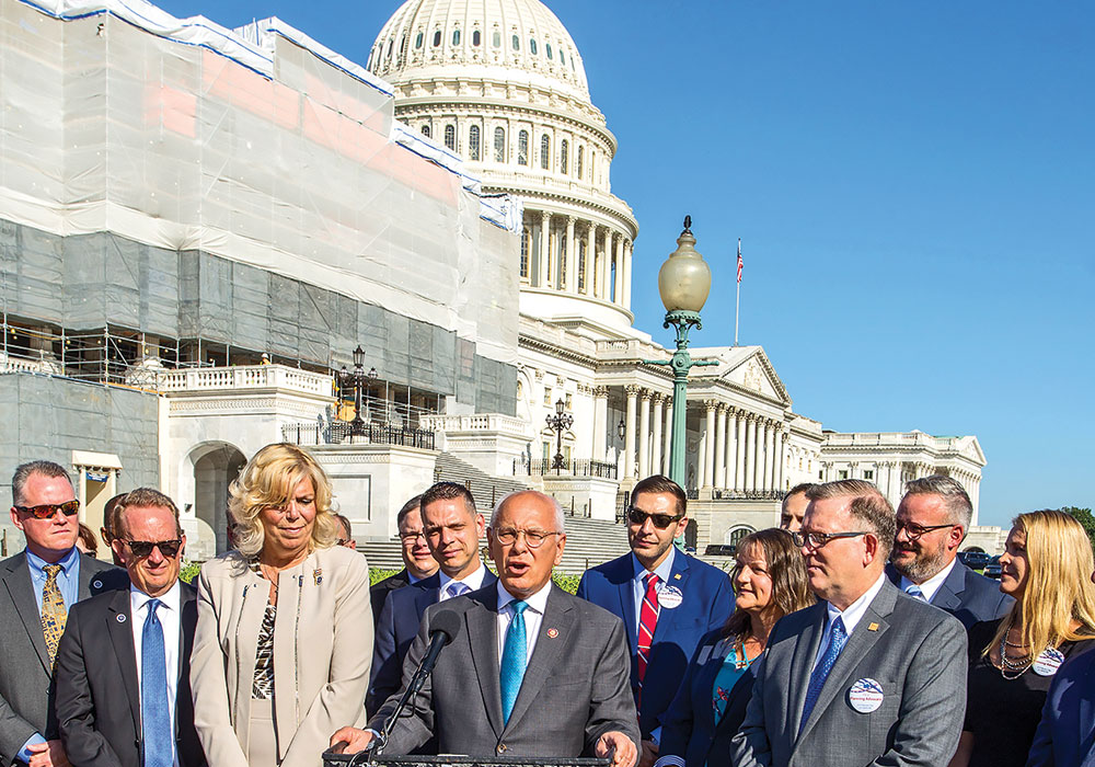 Representative Paul Tonko (D-N.Y., at podium) joined APA members, including President Kurt Christiansen, FAICP, (right) for the 2019 Great Places in America announcement on Capitol Hill. American Planning Association photo.