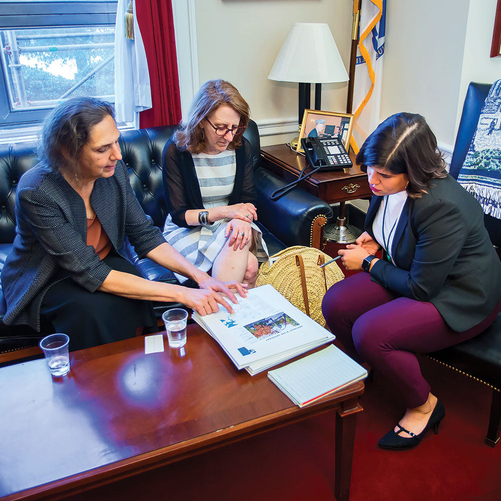 Carole Schlessinger and Deneen Crosby discuss a Massachusetts Great Place with U.S. Rep. Stephen Lynch's (D-Mass.) staff. American Planning Association photo.