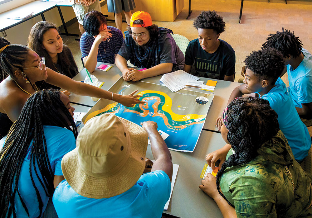 High school students learn about climate resiliency while playing Game of Floods at Towson University. Photo courtesy the National Aquarium.