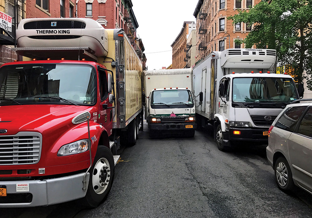 This tight squeeze on a New York City street is a not-so-rare sight thanks to our ever-increasing demand for deliveries around the clock. Photo by Tom Visée.