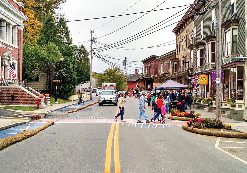 Residents in Bethel, Vermont, teamed up with AARP Livable Communities and Team Better Block to test bulb-outs, crosswalks, a mobility lane, and a parklet. The experiment led to permanent street changes and the revitalization of several downtown buildings. Photo courtesy Team Better Block.
