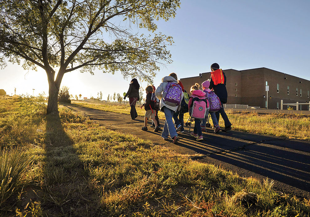 Safe Routes to School programs find ways to get kids on their feet — especially when schools are built on the outskirts of town. Photo by Eddie Moore/Albuquerque Journal/Zumapress.com.