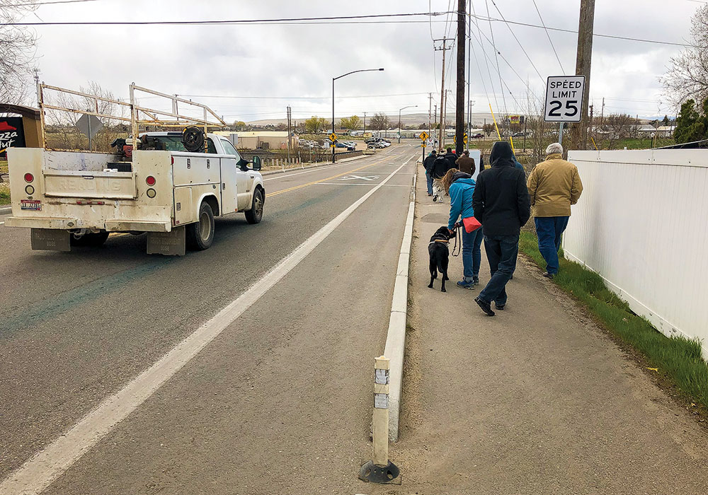Extruded curb treatments, like these in Kuna, Idaho, are used in Emmett and other rural areas to create safe pedestrian walkways without the full cost of sidewalks. Photo by Don Kostelec.