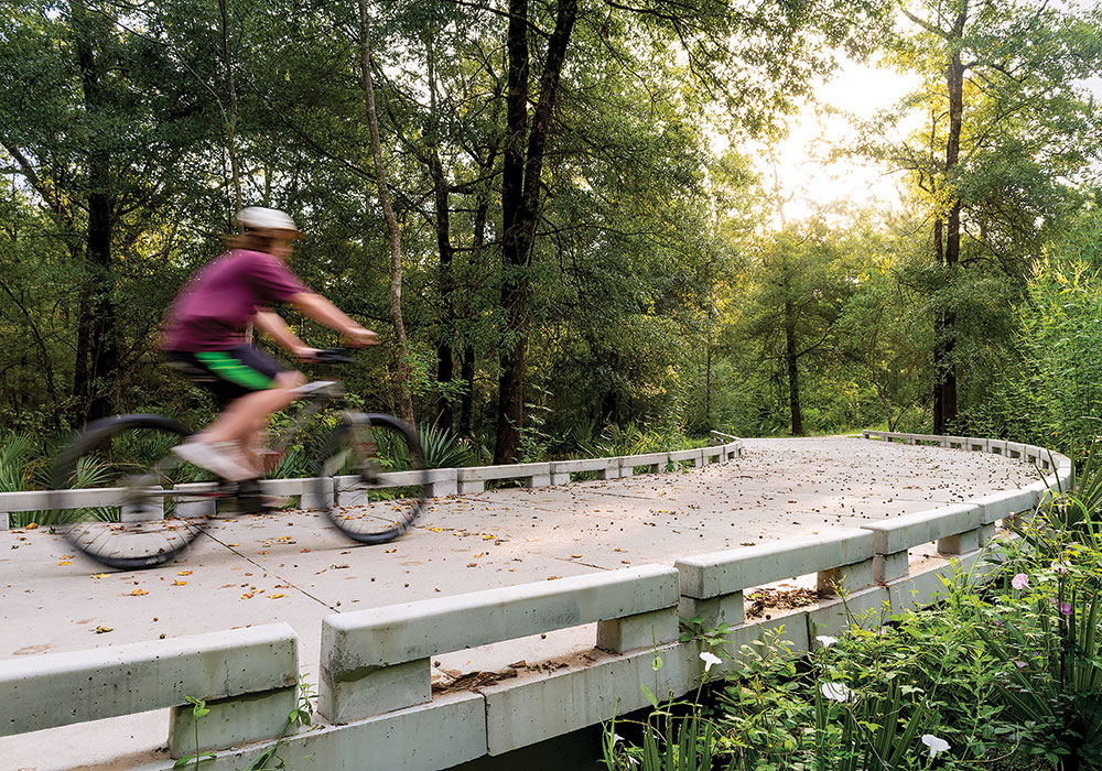 A ride along the Halls Bayou Greenway takes you past the old growth forests of Keith-Weiss Park as well as an all-abilities playground in Tidwell Park. Photo by Anthony Rathbun, courtesy Houston Parks Board.