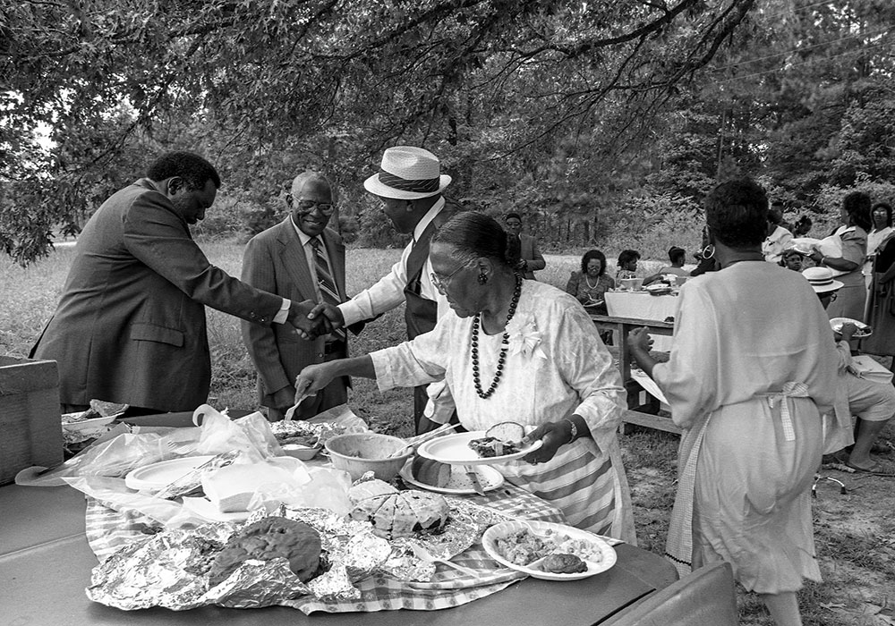 A local church hosts a picnic during County Line's 1991 homecoming. The three-day event, which still takes place today, honors the Texas freedom colony's history and residents — past, present, and future. Photo by Richard Orton.