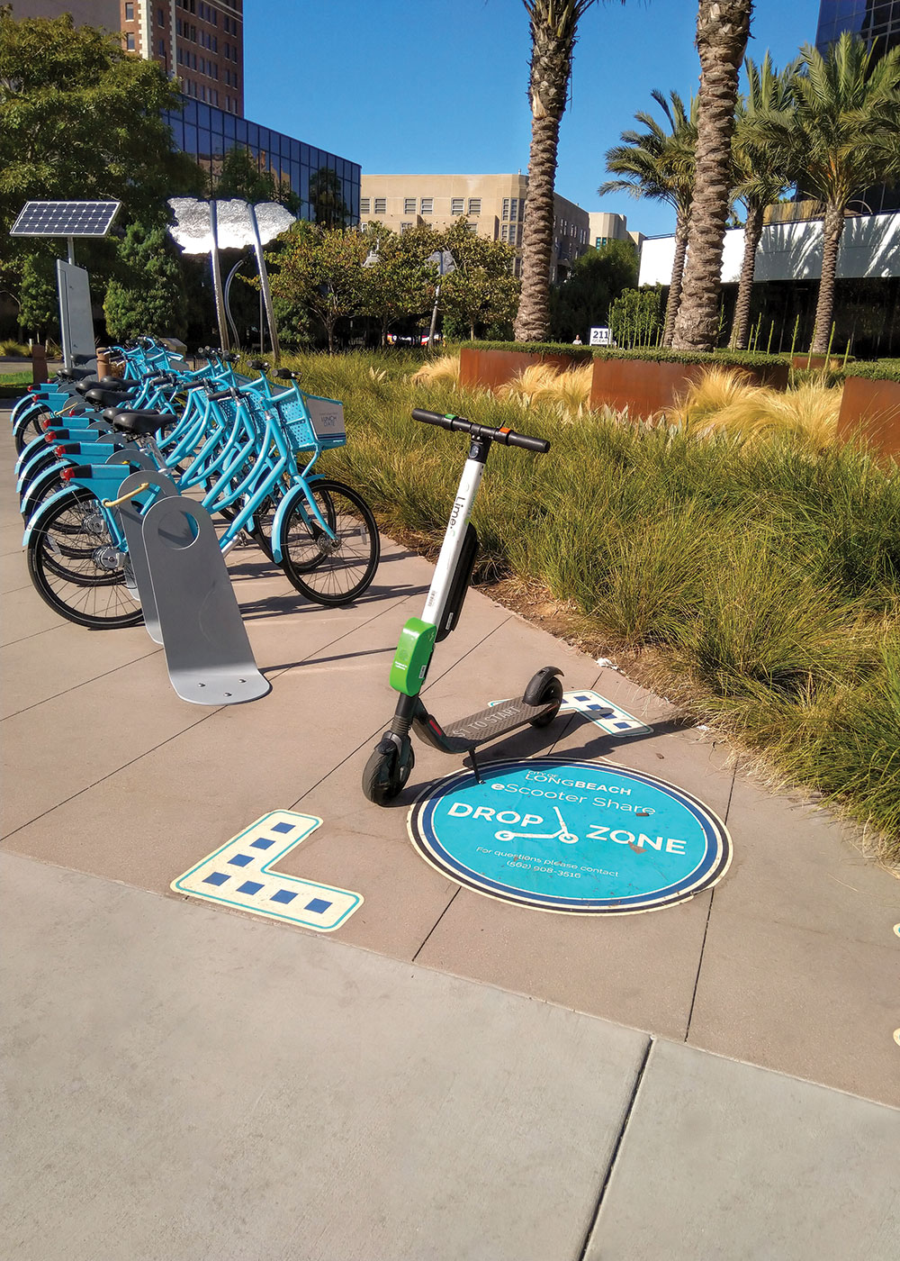 Long Beach, California, colocated a scooter drop corral with a bike-share dock to help keep sidewalks clear. Courtesy WGI.