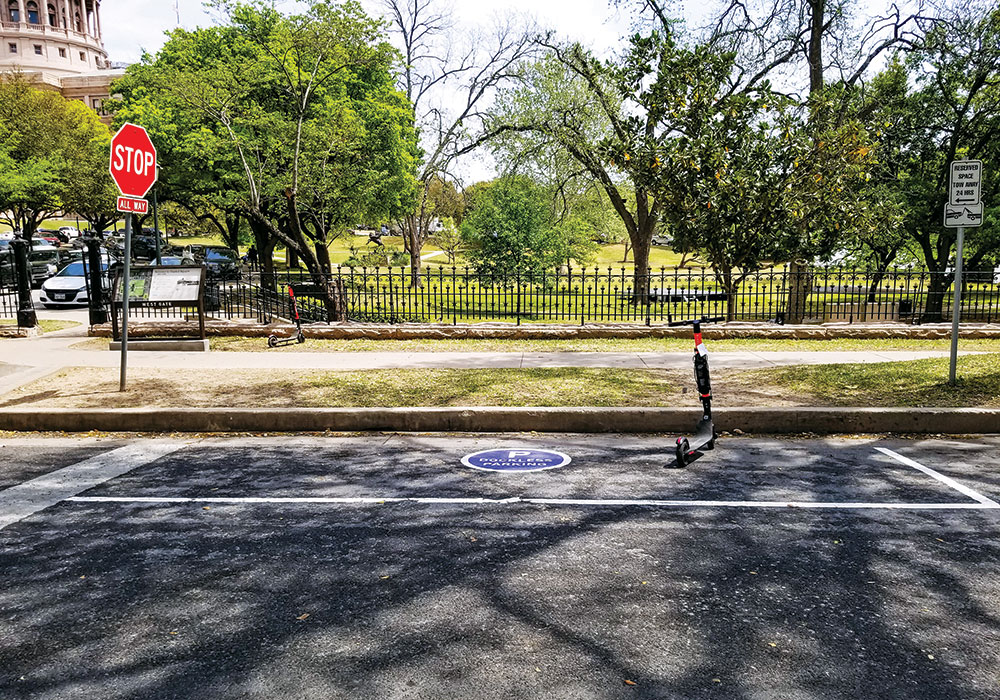 Austin, Texas, repurposed an on-street parking area to serve as a designated dockless scooter parking space, a concept that sometimes has had mixed success. Photo courtesy Austin Transportation Department.