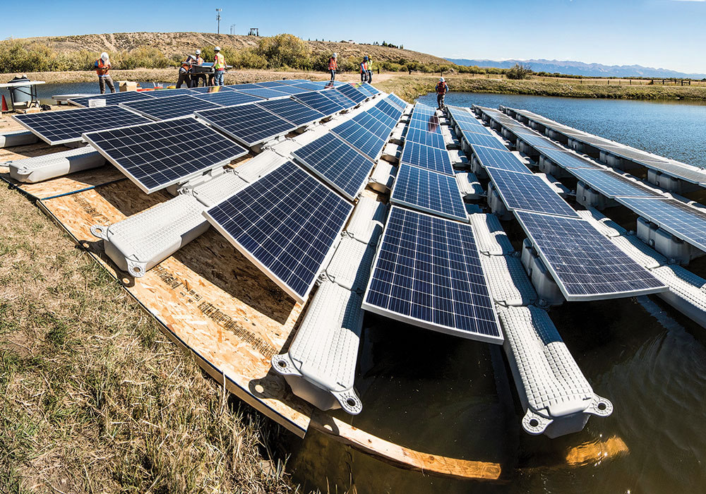 Floating PV arrays (such as this one on a water treatment facility in Walden, Colorado) can reduce evaporation and algae growth. Photo by Dennis Schroeder, NREL/DOE.