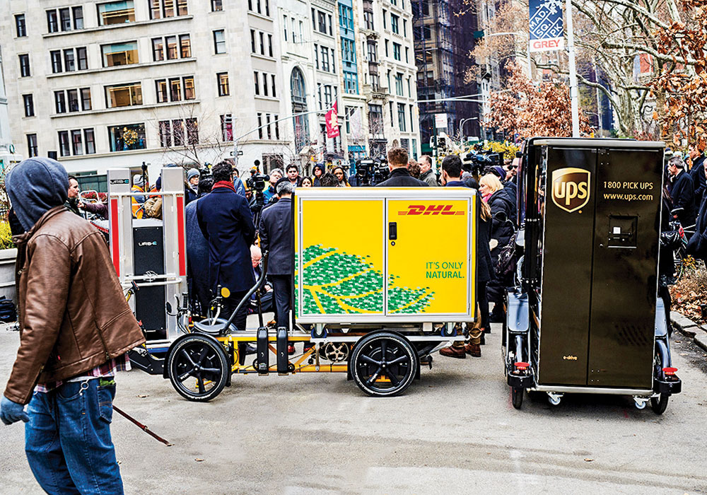 As part of a pilot program, as many as 100 pedal-assisted cargo bikes operated by Amazon, UPS, and DHL will be allowed to park in hundreds of existing commercial loading areas that are typically reserved for trucks and vans in the most congested parts of Manhattan.