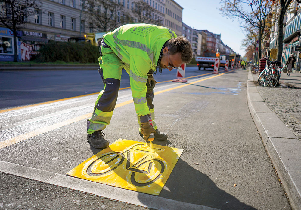 Berlin is transforming a number of vehicle lanes into bike lanes to promote cycling during the coronavirus pandemic. While this one on the thoroughfare Kottbusser Damm is temporary, the city plans to install a permanent version in September. Photo by J'rg Carstensen/Picture-Alliance/DPA/AP Images.