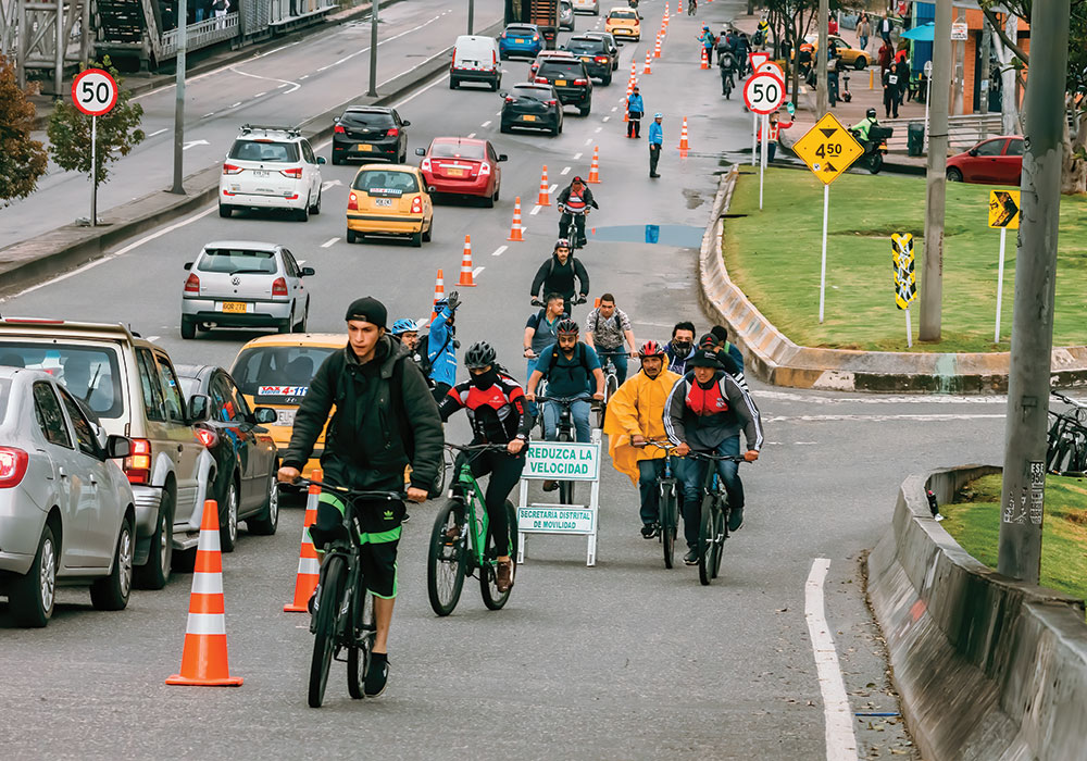Bogotá residents take advantage of a temporary bike lane along busy 80 Street Avenue, one of many pop-ups added to the city's 340 miles of existing bike lanes. Photo by Gabriel Leonardo Guerrero Bermudez/iStock Editorial.