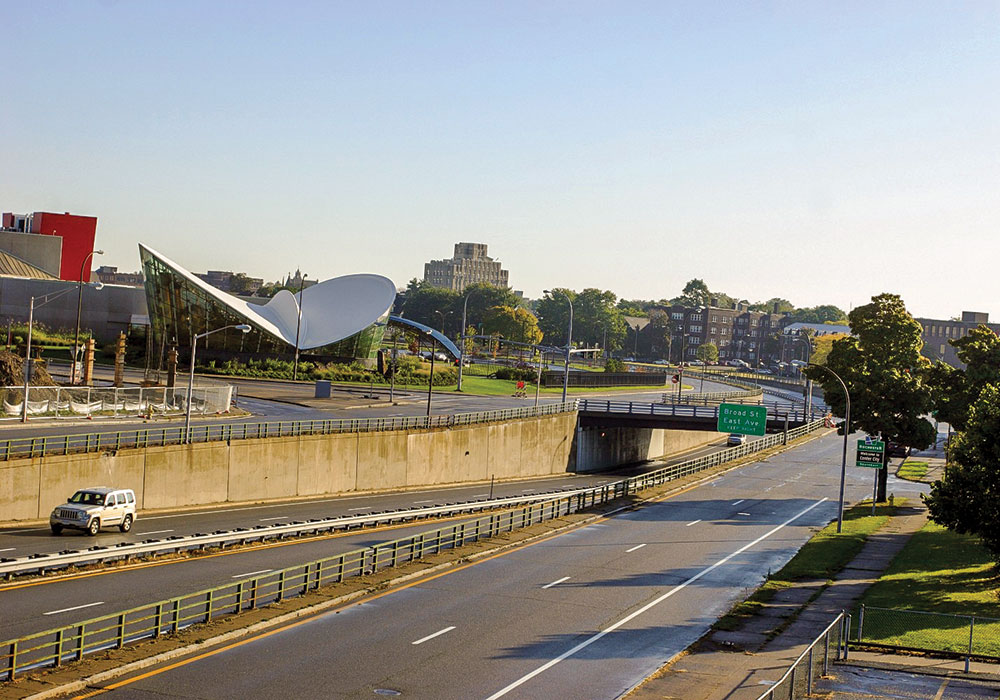 The six-lane I-270 highway that had for decades divided the eastern part of Rochester, New York, was removed and replaced in 2018 with new complete streets. Wikimedia photo by AIP3745.