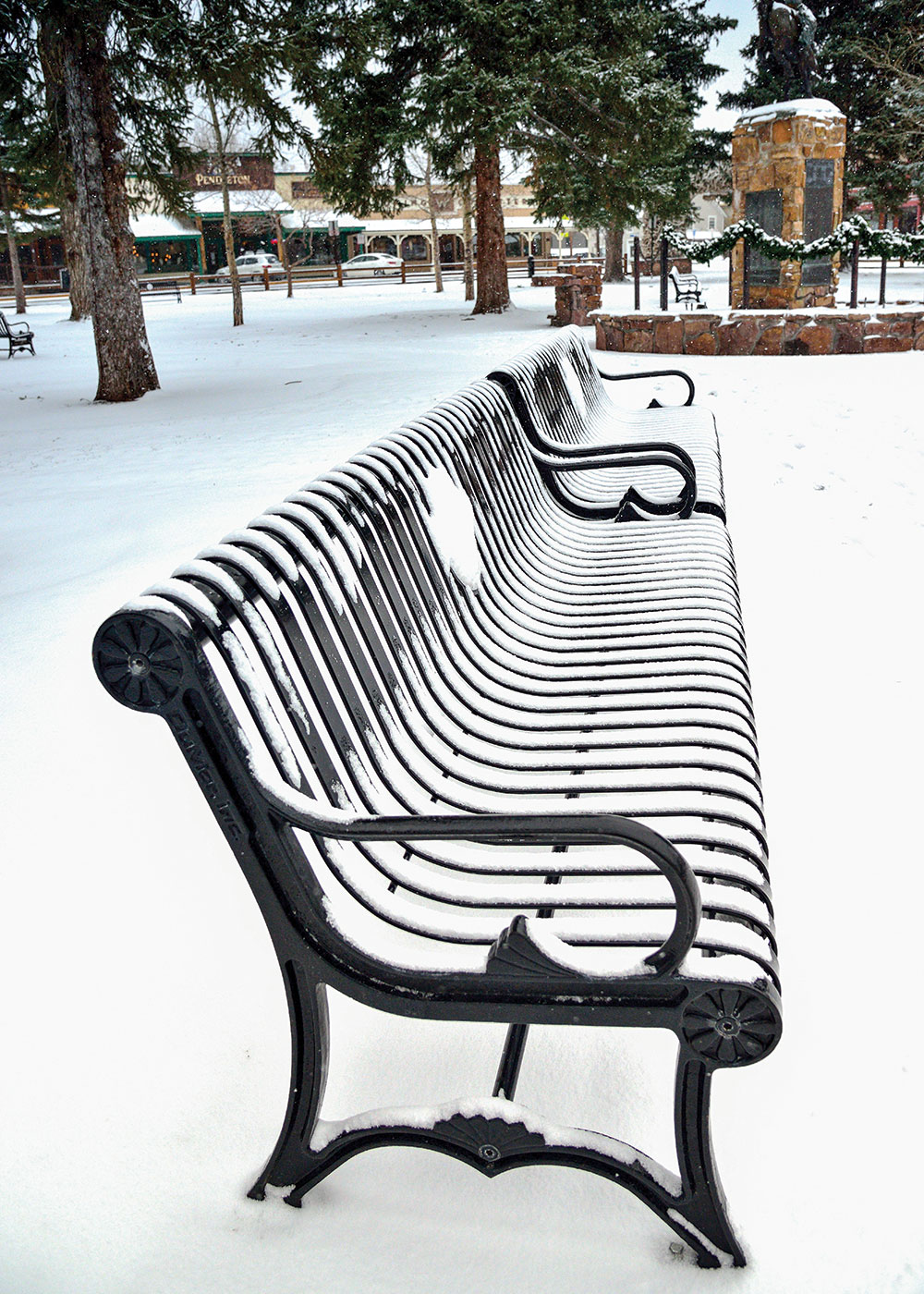 Officials scrapped plans for Western-themed benches made of elk antlers in favor of benches designed to accommodate seniors — with rounded armrests, slightly angled backrests, and no sharp edges — in downtown Jackson Hole, Wyoming's Town Square. Photo by Ivan Sebborn/Alamy Stock Photo.