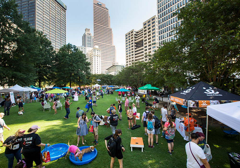 Playful events like the Doggy Con Pet Parade and Costume Contest in Atlanta's Woodruff Park allow people from all walks of life to come together. Photo by Raftermen.