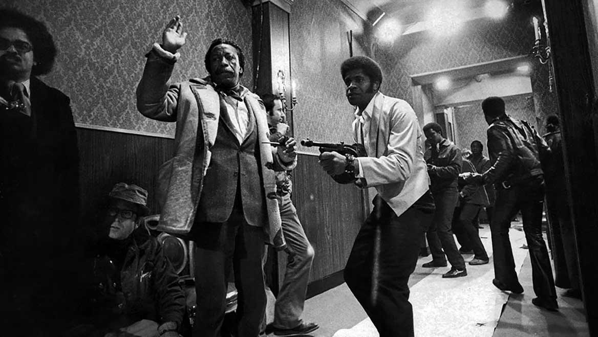 Gordon Parks (with hand raised) directing Shaft in 1971. Photo by Librado Romero/The New York Times.