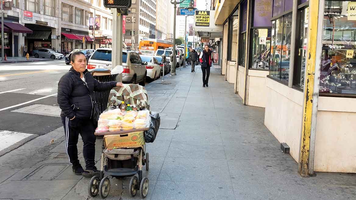 Local policies often create significant financial and legal barriers for street vendors through pricey permits and penalties like fines, misdemeanor charges, and even jail time. Photo by Rudy Espinoza.