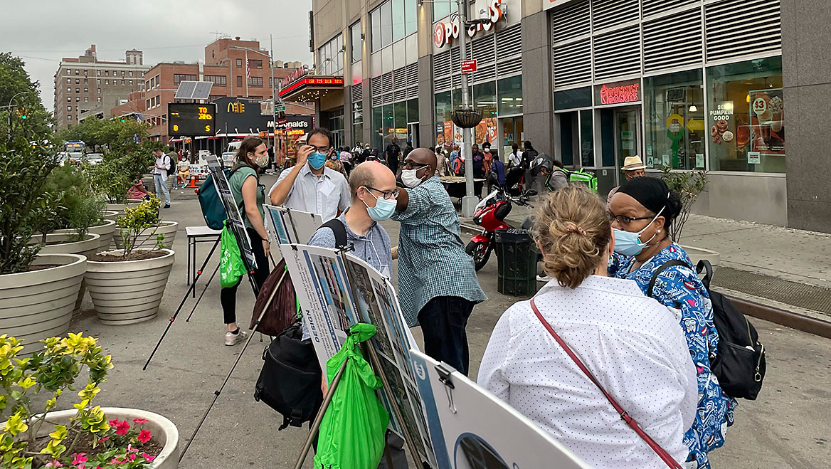 During an outdoor open house in downtown Jamaica, Queens, planners were able to reach a broader audience on a plan for busways in the area. Photo courtesy NYC DOT.