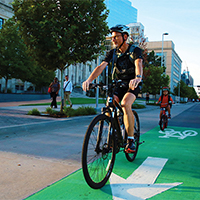 A bicyclist enjoys one of the first protected bike lanes built under the city's planokc.
