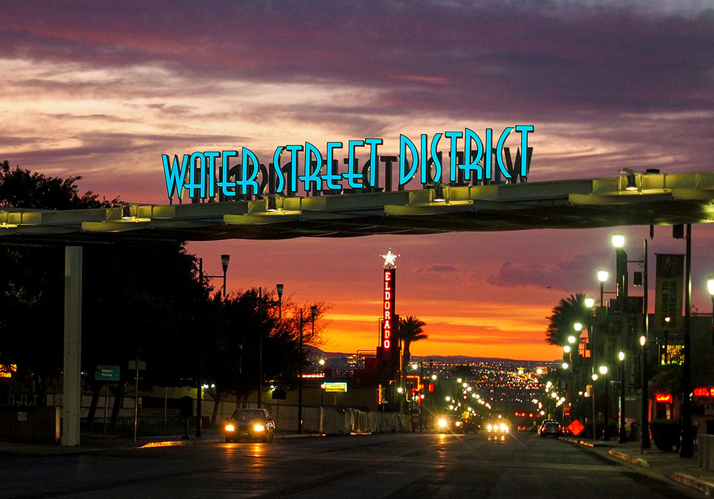 Water Street District welcome sign at sunset. Photo by Mikel Photography.