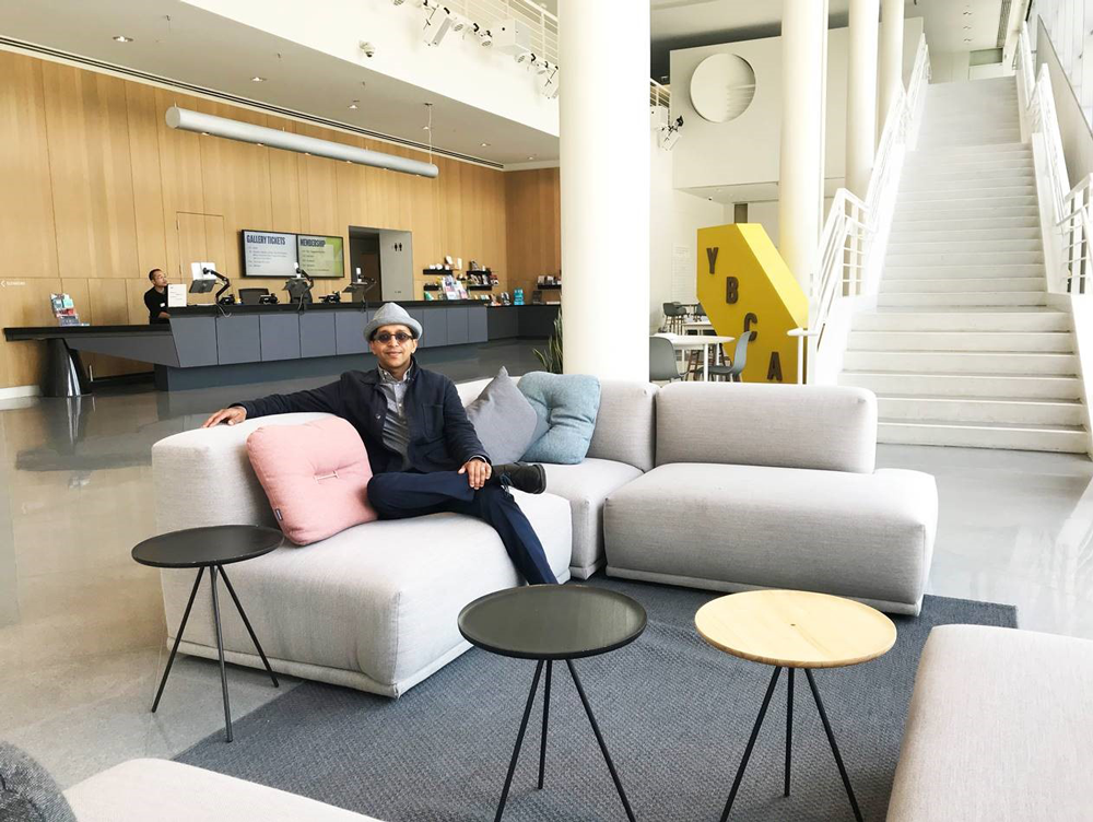 Amit Price Patel in the lobby of the Yerba Buena Center for the Arts. Patel's firm worked on a public realm placemaking study for the center and led the conceptual design for the lobby renovation. Photo courtesy Amit Price Patel.