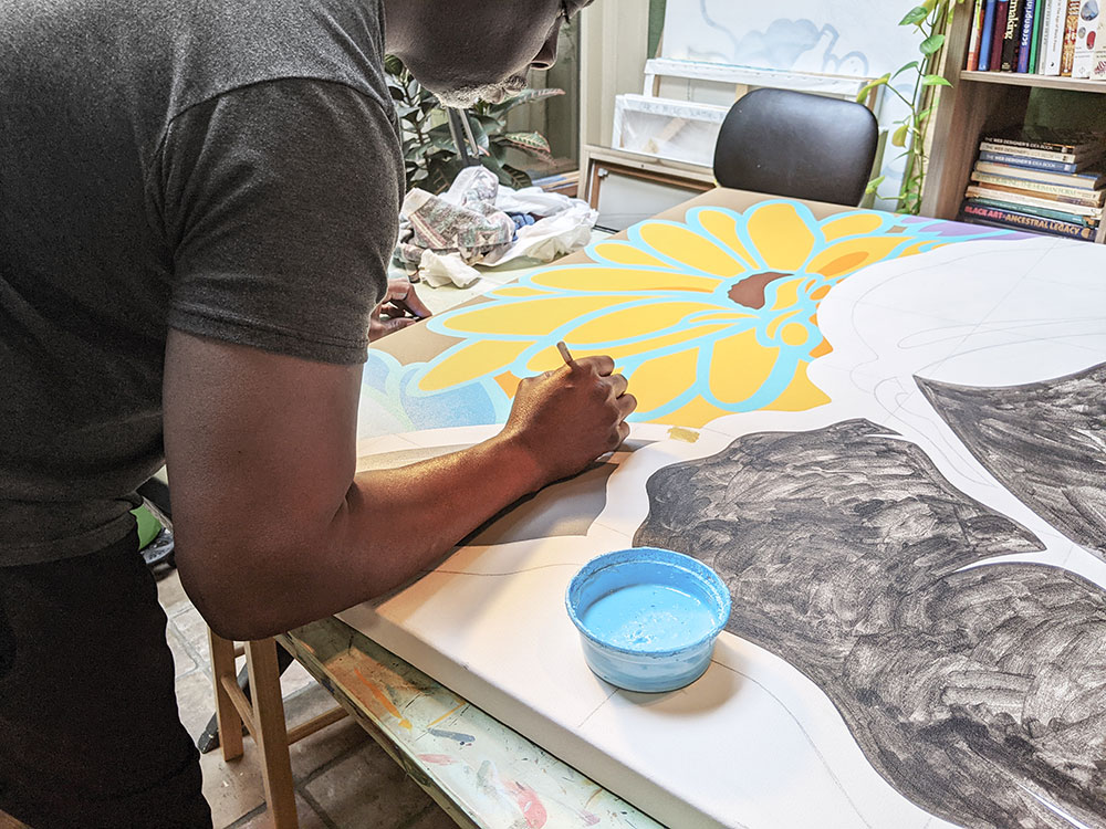 """Moore working on his """"My South"""" painting."""