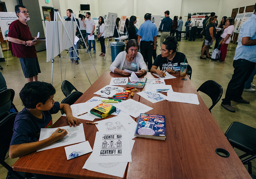 Two community stakeholders complete a survey during a Boyle Heights Community Plan Update open house. Image: Los Angeles City Planning
