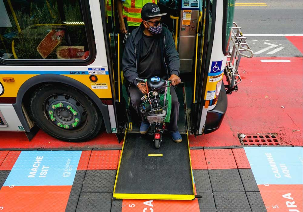 A raised bus boarding platform featuring on-ground signage with social distancing guidance in Everett. Photo by BostonBRT.