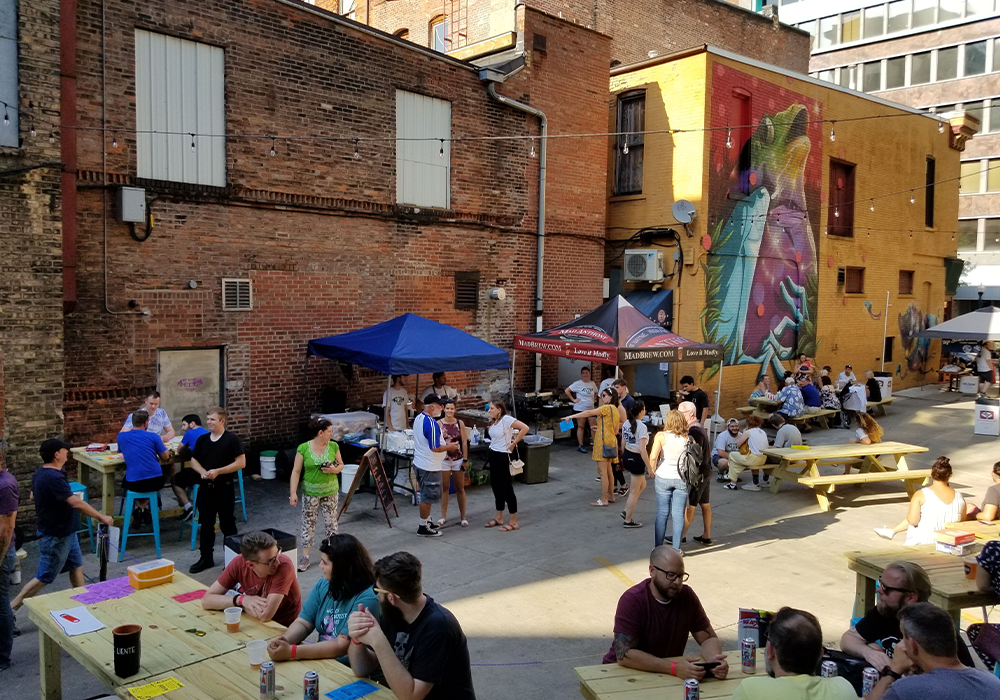 When the space is activated, the alleyway doubles the usable space and becomes a part of the experience. Photo Credit: Fort Wayne Community Development