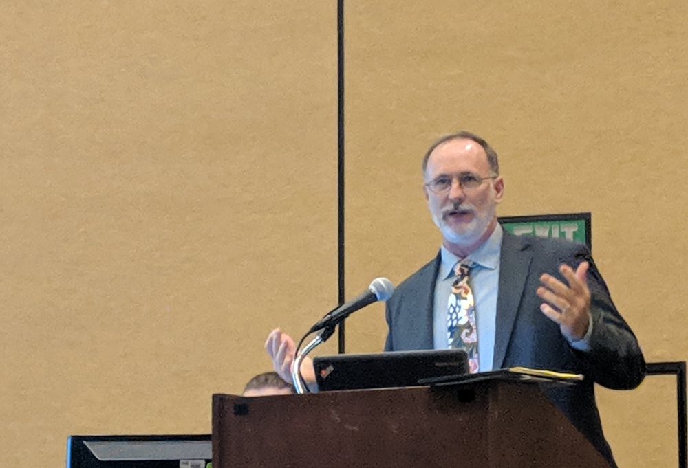 Jim Holloway, executive director for the Babbitt Center for Land and Water Policy, offers an overview of integrating water into comprehensive plans and land use into water utility plans. Photo by Molly Walsh.