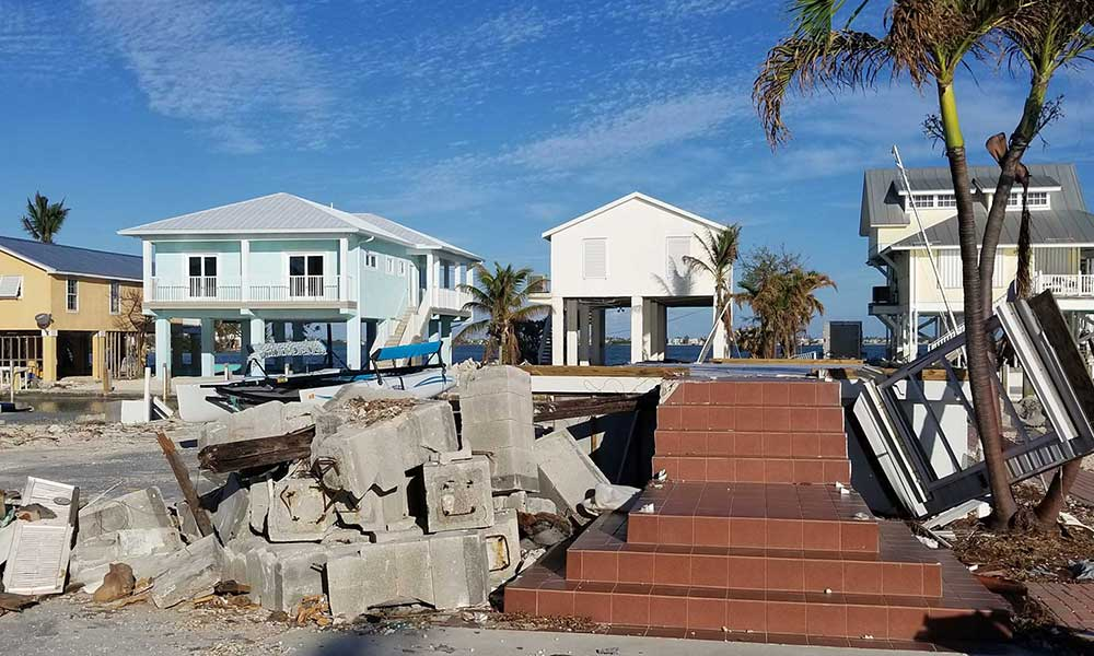 An example of wind mitigation in action in Marathon, Florida: The remnants of the home in the foreground were from an older structure, while the homes in the background were built to code. The home in the foreground was sadly unable to withstand the destruction of Hurricane Irma. Photo courtesy Julie Dennis.