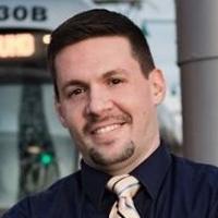 Headshot of Ryan Wozniak.